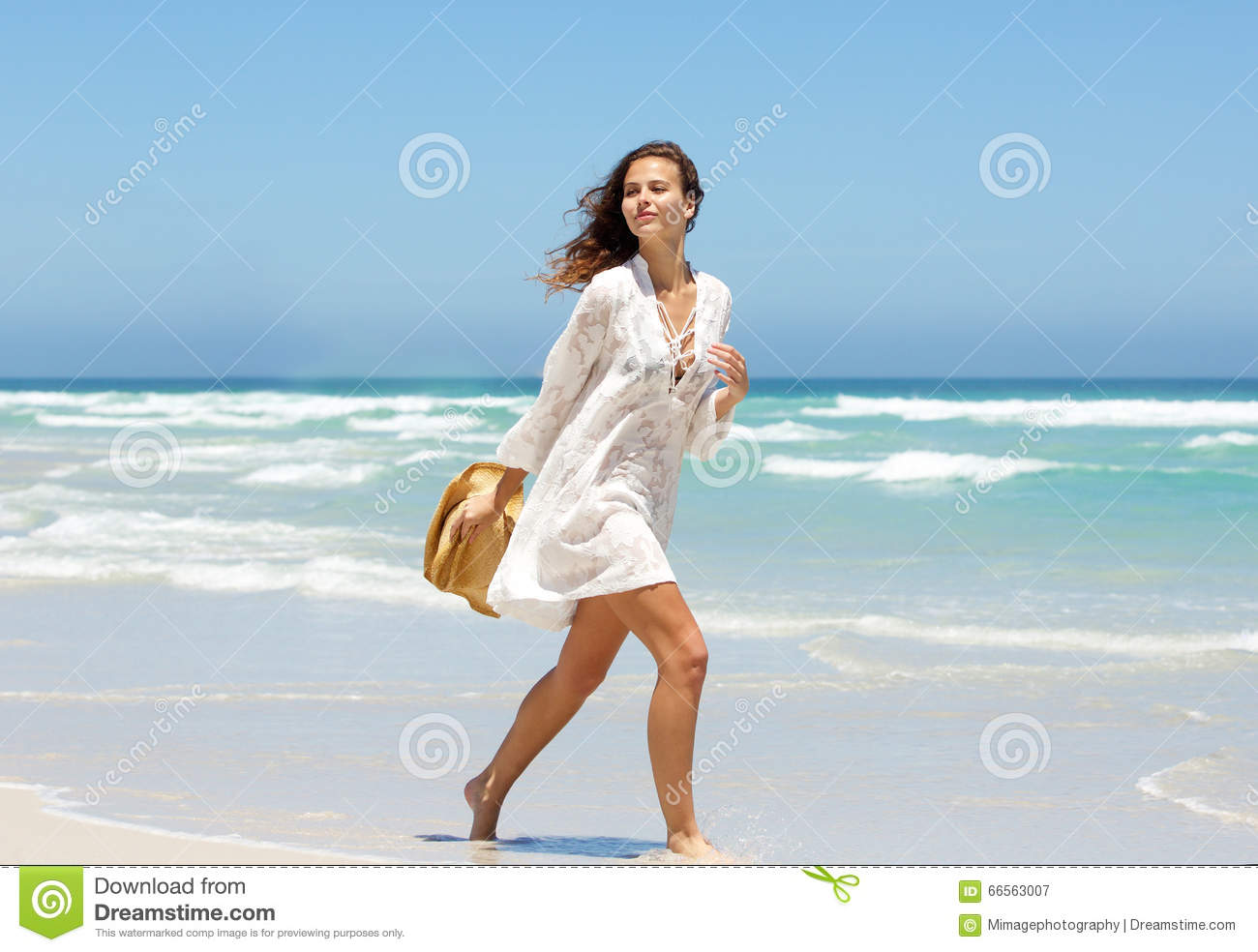 Woman walking on a beach royalty - Beautiful Young Woman Walking On Beach In Summer Dress Royalty Free Stock Photo