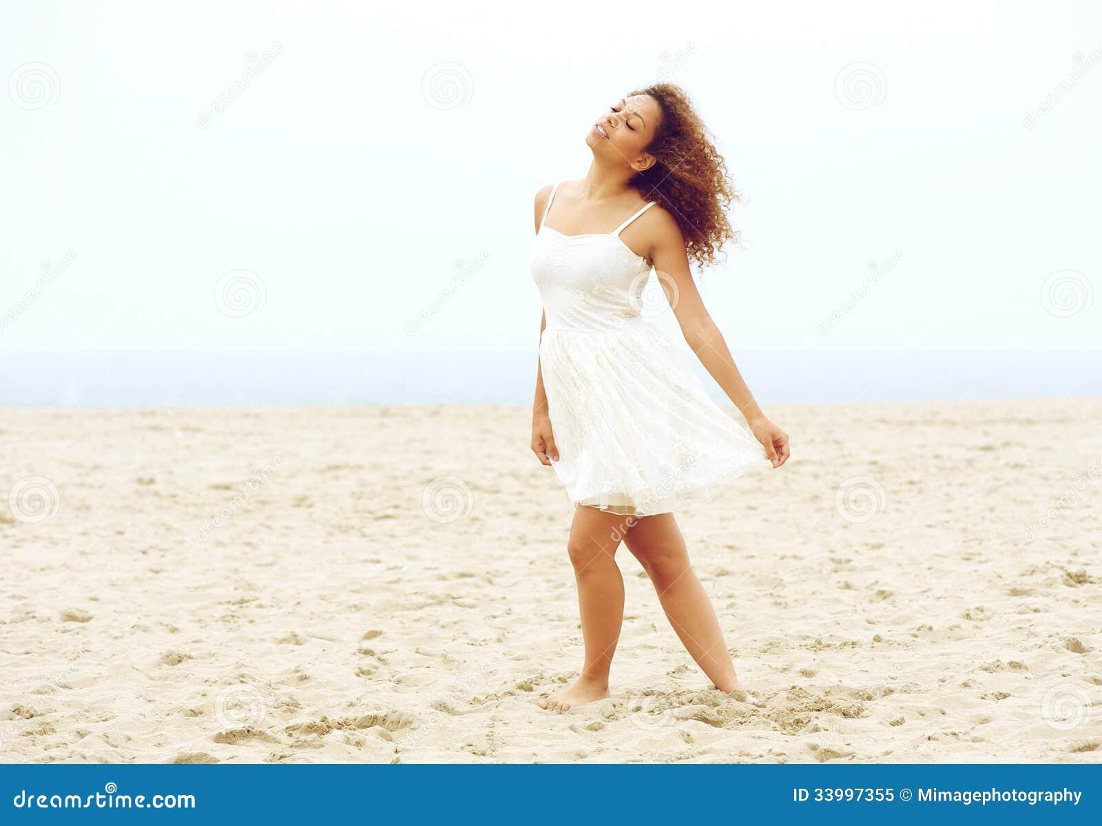Beautiful Young Woman Walking On Beach In White Dress ...