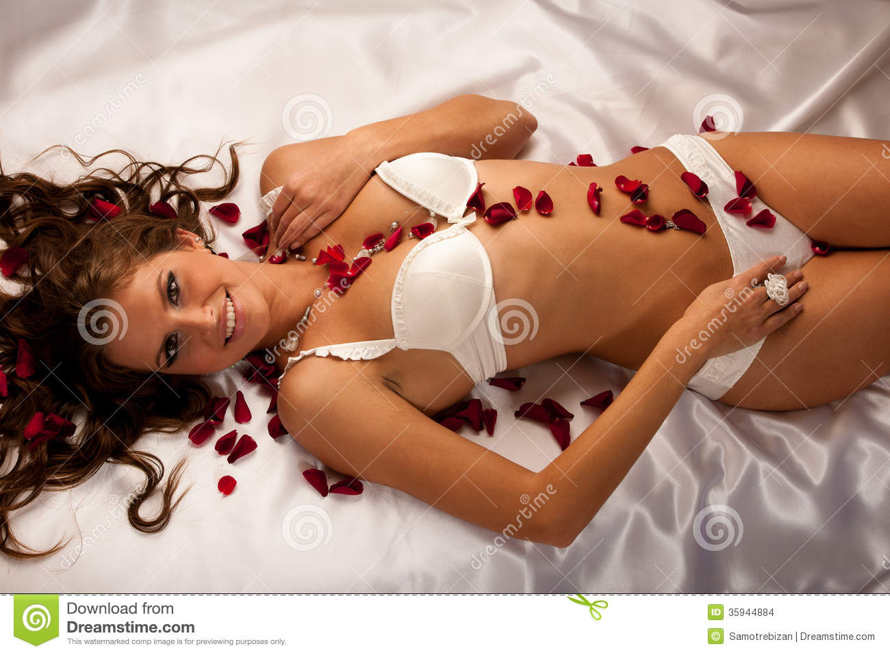 ... White Lingerie Lying In Bed Of Ros Stock Images - Image: 35944884