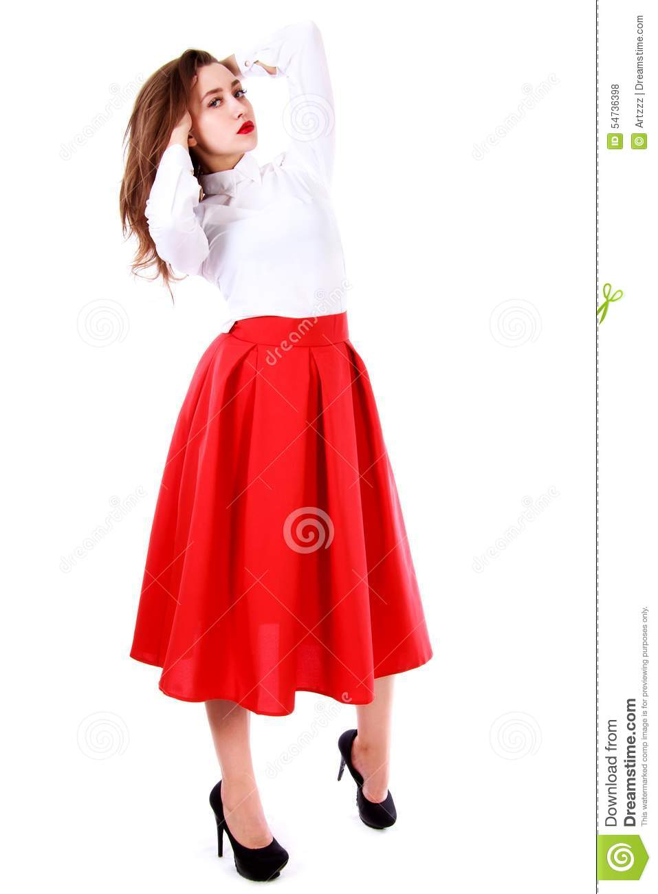 f0aa63577352 Beautiful young woman in a white blouse and a long red skirt isolated over  white background