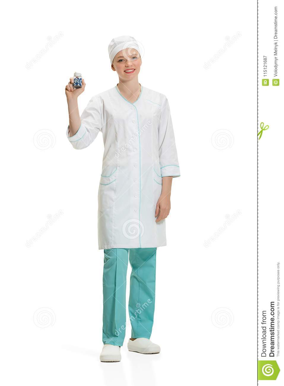 Beautiful young woman in white coat posing at studio. Full length studio shot isolated on white.