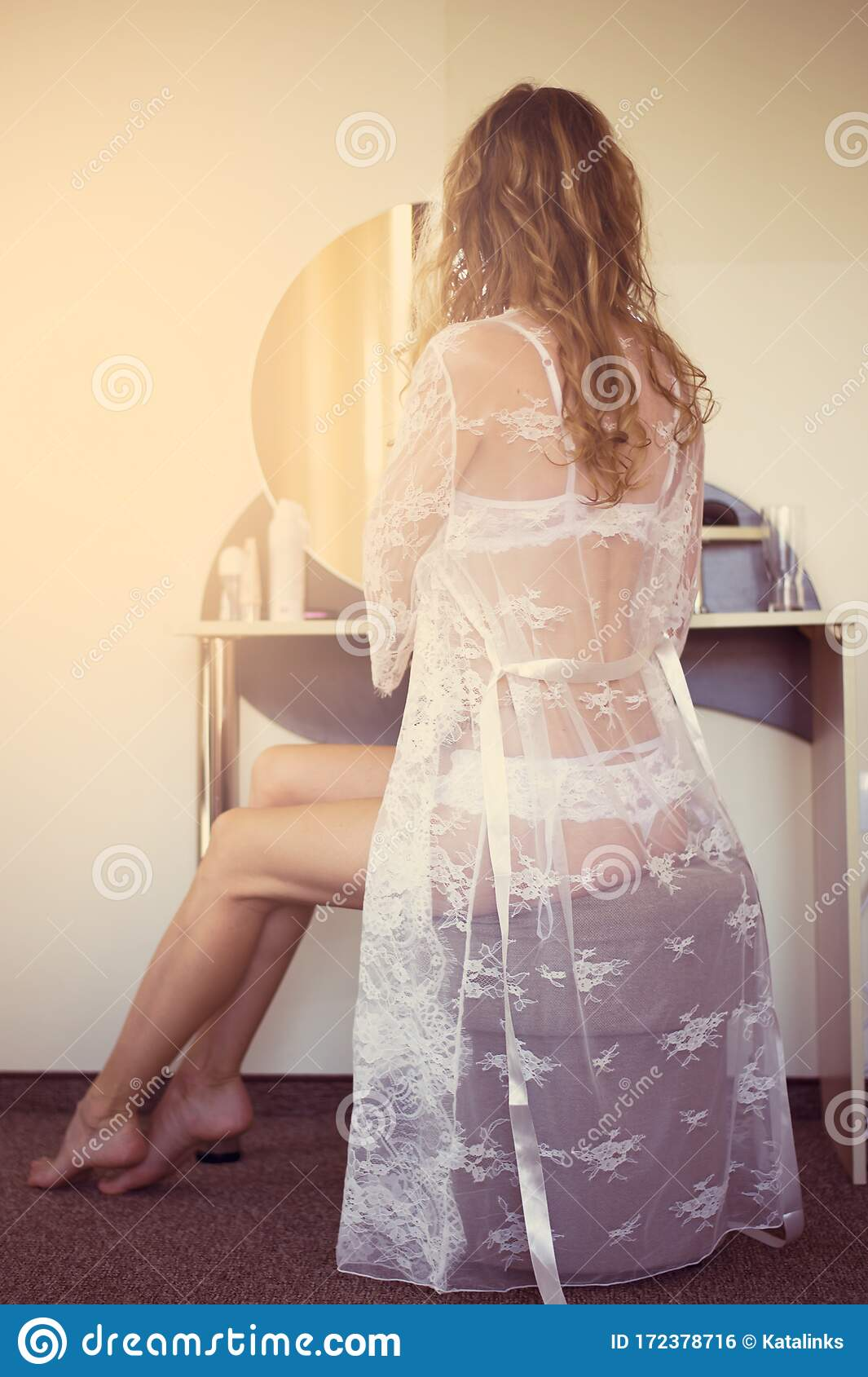 Beautiful Young Woman In White Lace Peignoir Sits In Front Of A Mirror In A Boudoir In Bedroom Stock Photo Image Of Ottoman Lace 172378716
