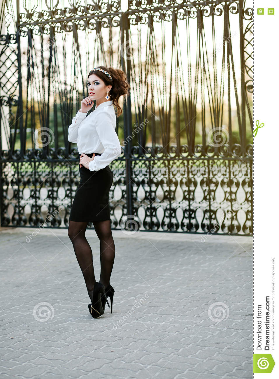 Beautiful Young Woman In White Shirt And Black Skirt In