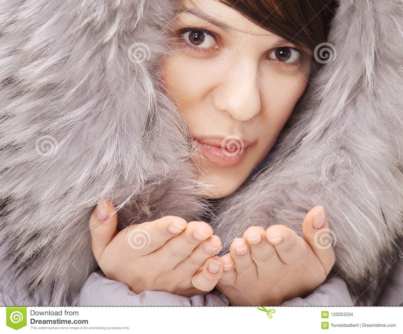 cba023d12310d Beautiful Young Woman In Winter Jacket Making A Kiss. Stock Photo ...
