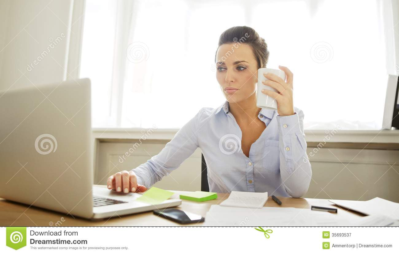 Beautiful Young Woman Working In Home Office Royalty Free Stock