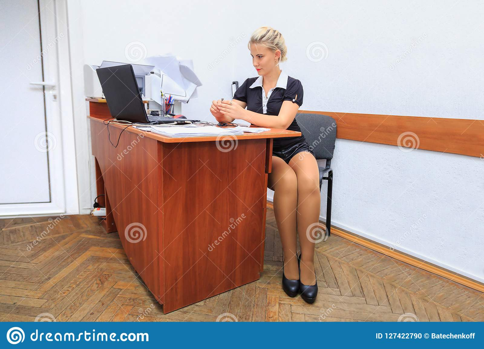 Beautiful young woman works in office