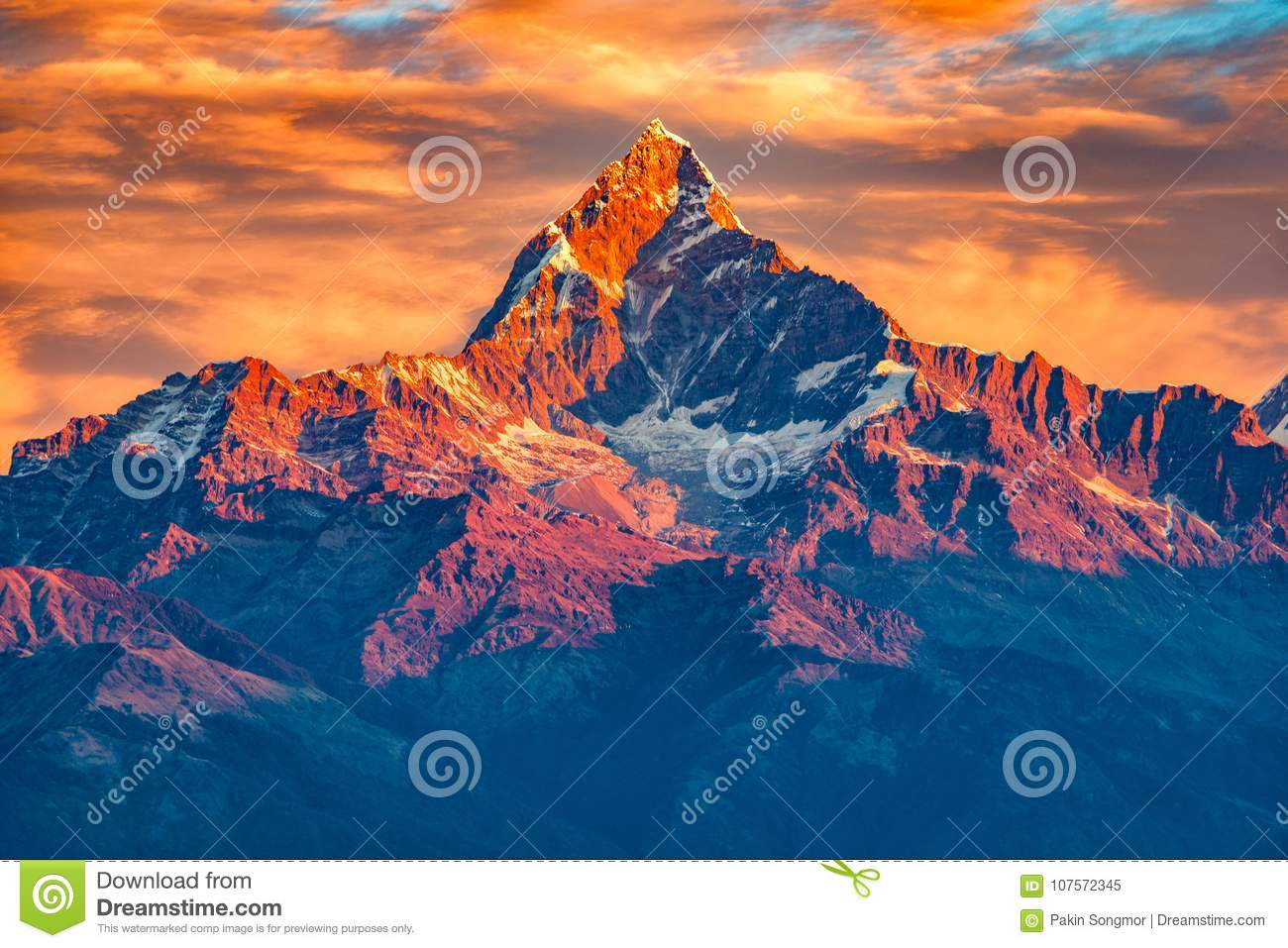 Beautifull cloudy sunrise in the mountains with snow ridge fron Himalaya view point