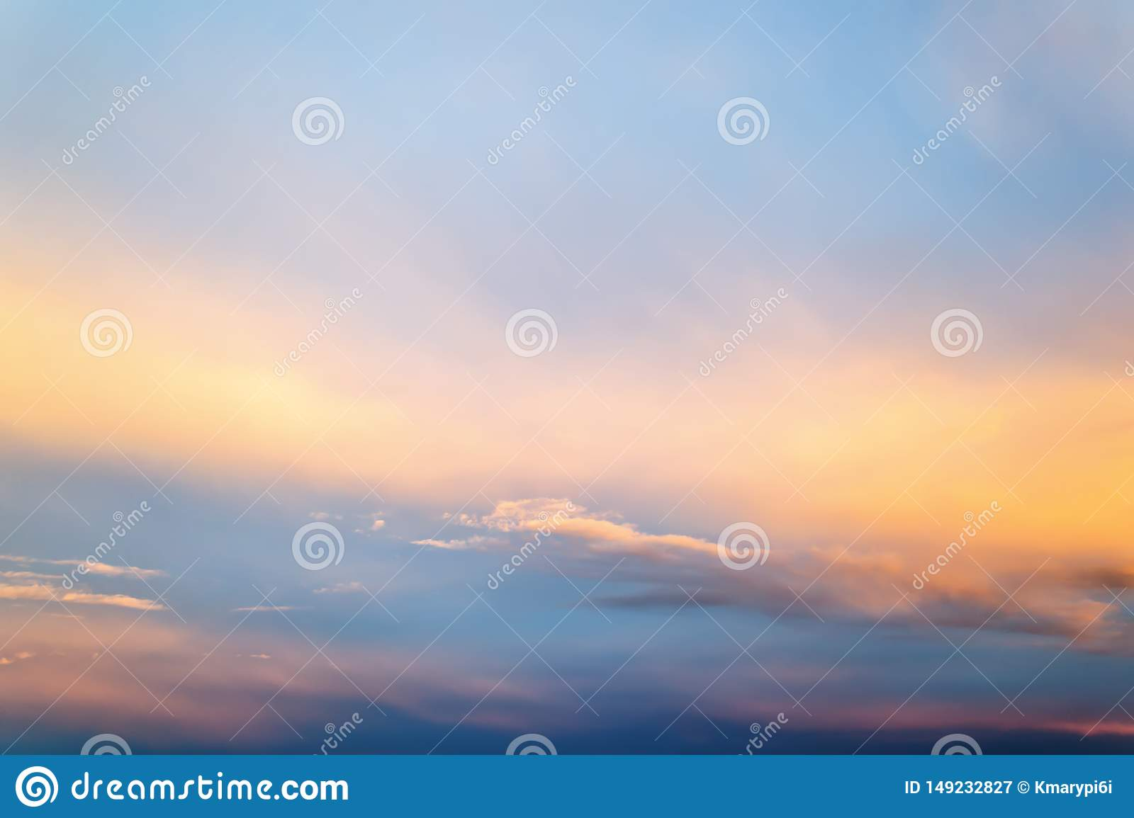 Beautifull skyscape at evening. Blue clear sunset sky with white and orange clouds. Calm background