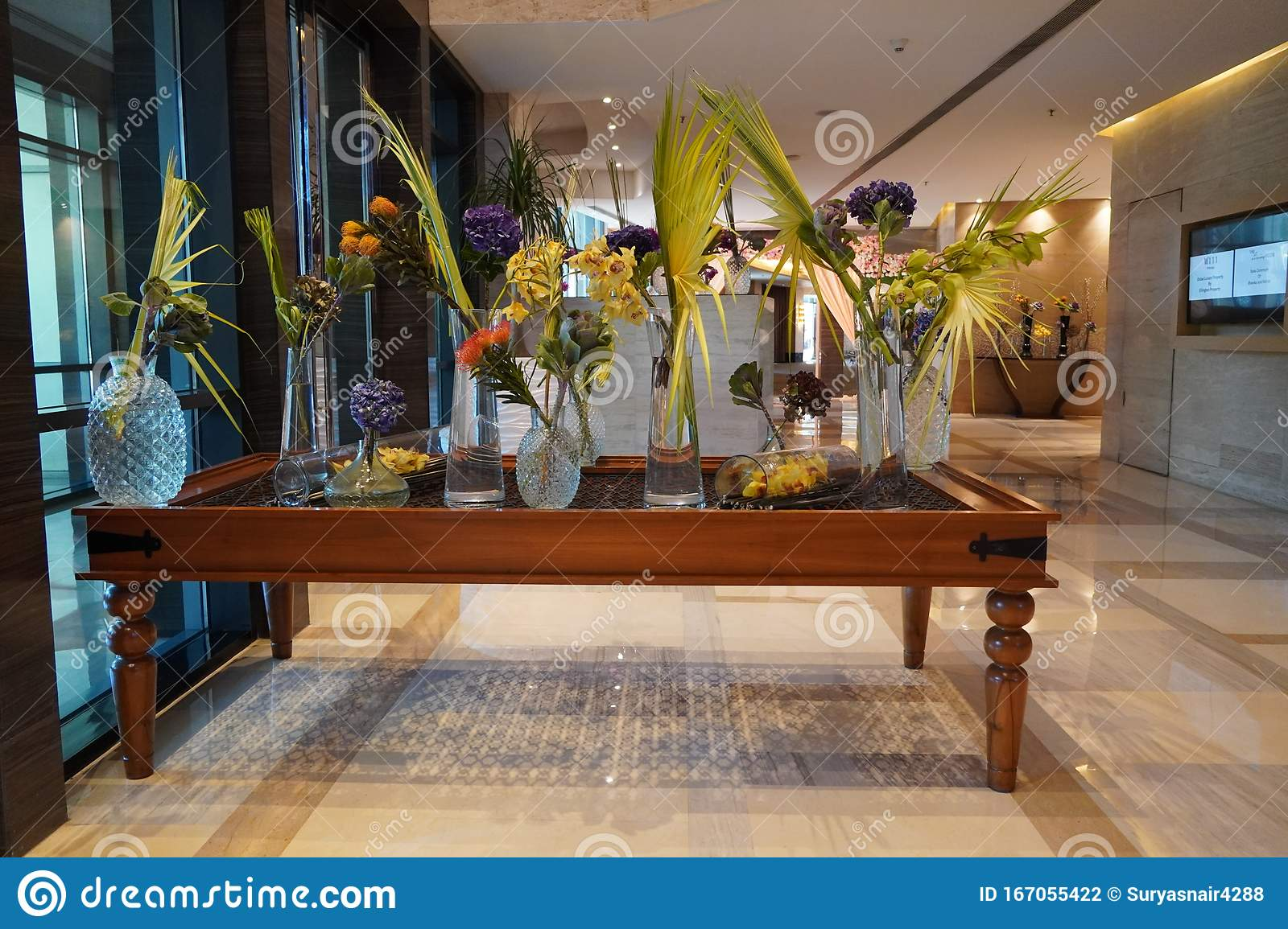 Beautifully Arranged Flowers In Flower Glass Pots On The Table Elegant Flowers Arrangement In Vases In Hotel Lobby Flower Editorial Photography Image Of Bloom Fresh 167055422
