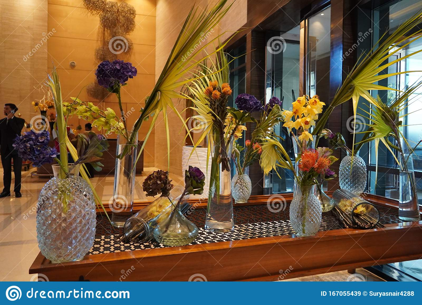 Beautifully Arranged Flowers In Flower Glass Pots On The Table Elegant Flowers Arrangement In Vases In Hotel Lobby Flower Editorial Stock Image Image Of Flora Flower 167055439