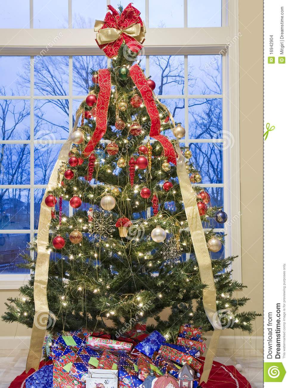 Beautifully Decorated Christmas Tree By A Window Stock