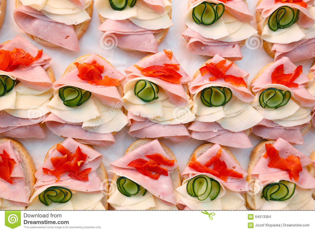 beautifully decorated food snacks and appetizers with sandwich on party or wedding celebration stock