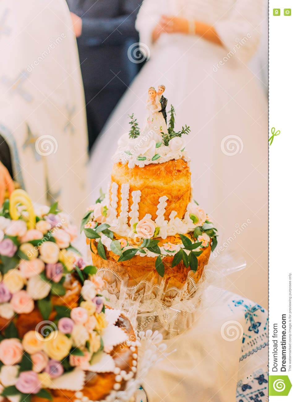 Beautifully Decorated Traditional Wedding Bread With Blurred Couple