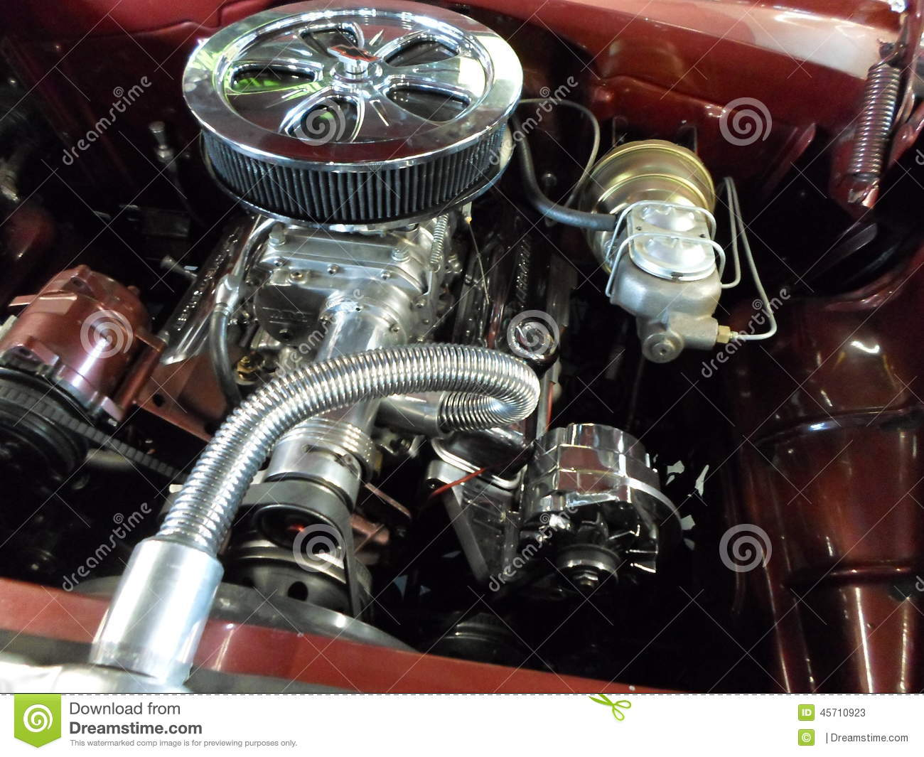 A Beautifully Restored Classic Car Engine With Chrome Parts. Stock ...