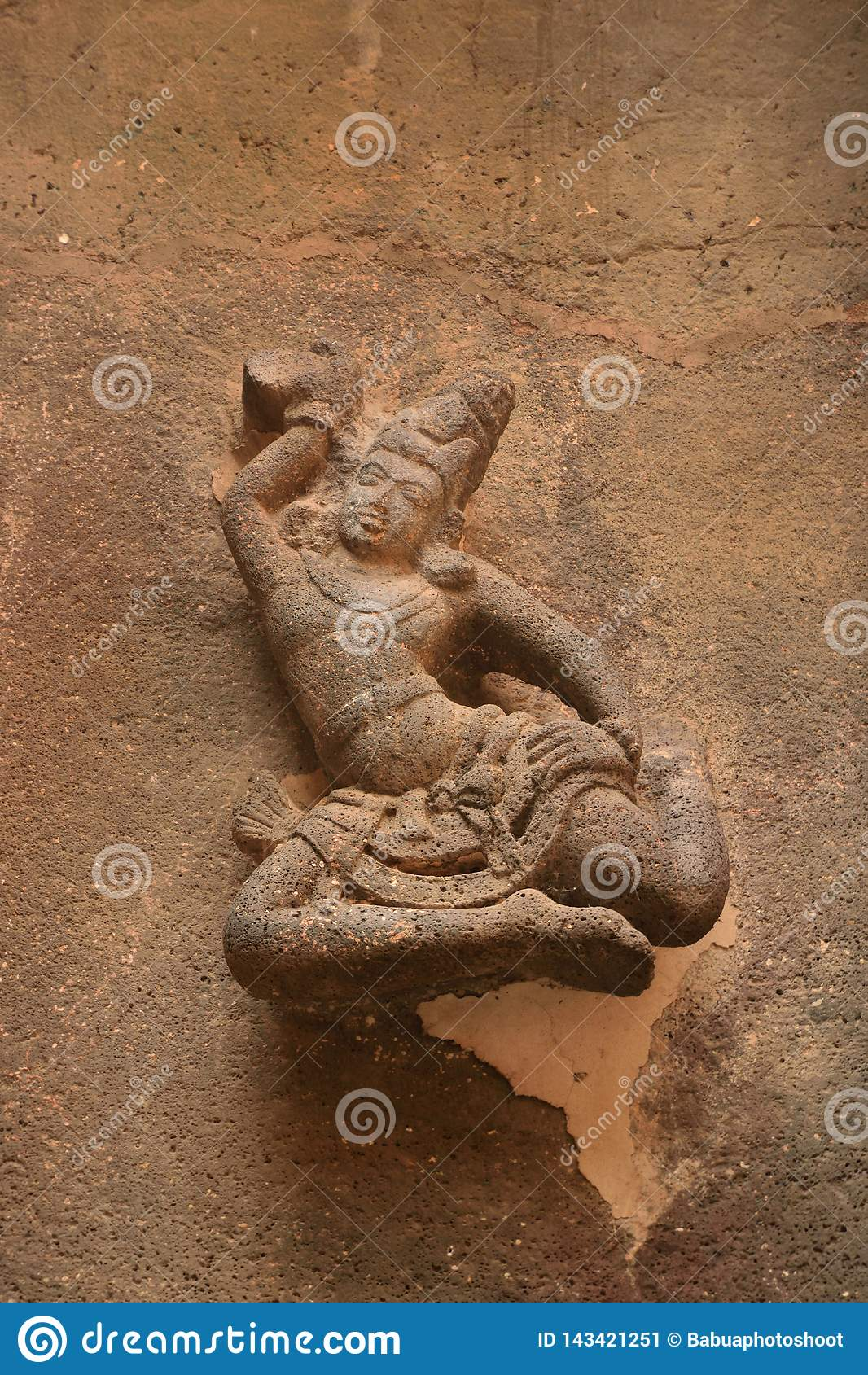 Beautifully sculptured figure of dancing girl on the walls of Kailasa temple, India