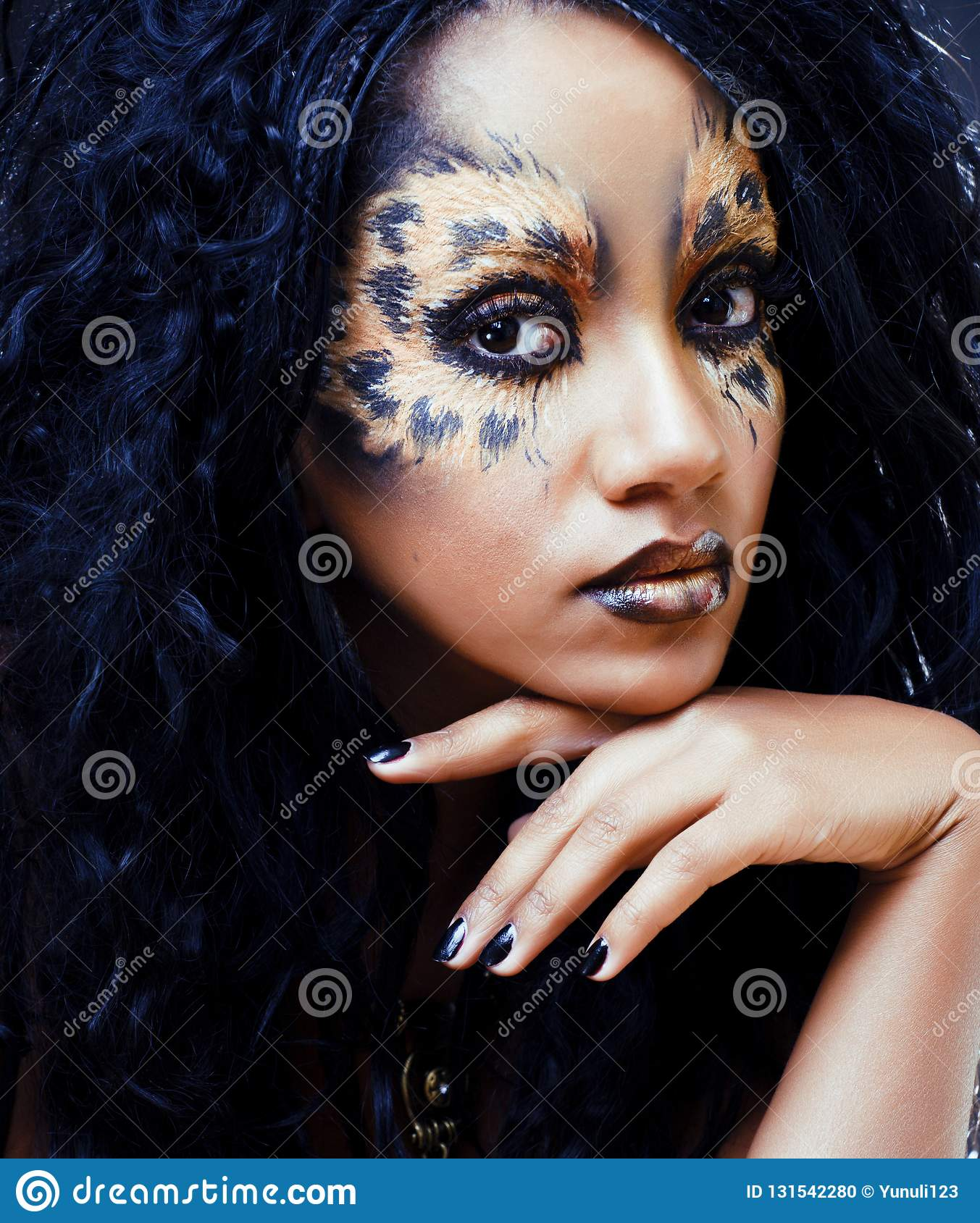 beauty afro girl with cat make up, creative leopard print closeu