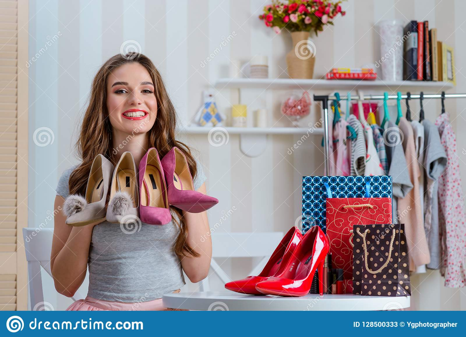 Beauty blogger holding pump shoes