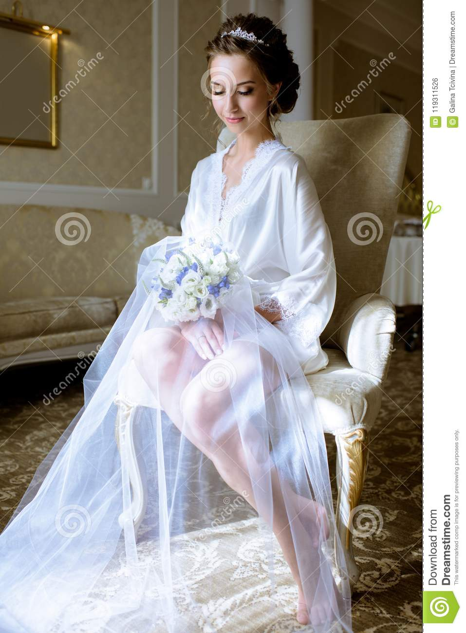 Beauty Bride In Dressing Gown With Bouquet Indoors Stock Photo ...