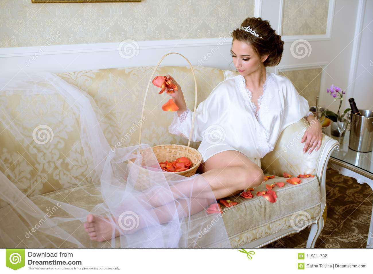 Beauty Bride In Dressing Gown With Bouquet And Lace Veil Indoors ...