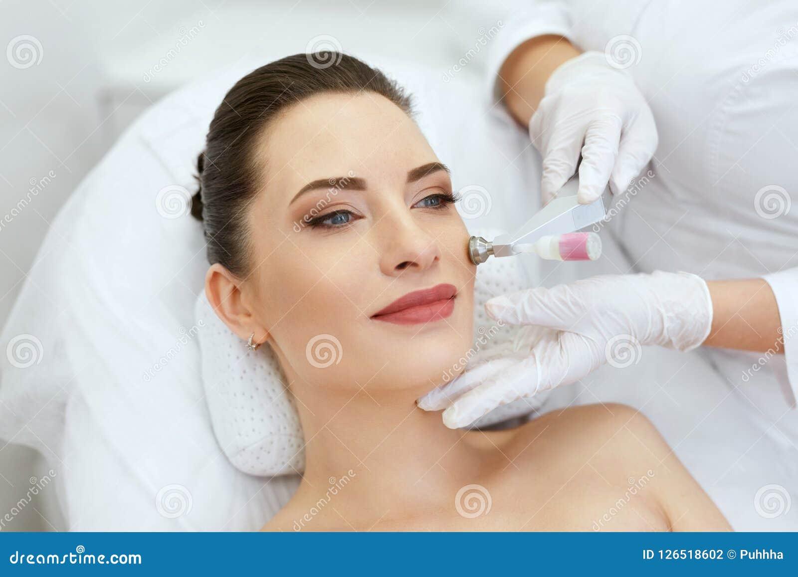 Beauty Clinic. Woman Doing Face Skin Cryo Oxygen Treatment