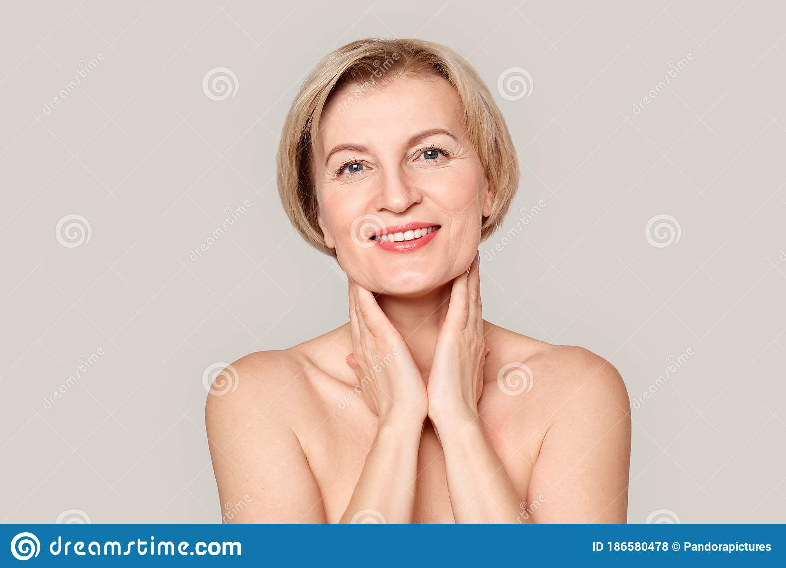 Mature women smiling nude Mature Woman Smiling Touching Neck Photos Free Royalty Free Stock Photos From Dreamstime