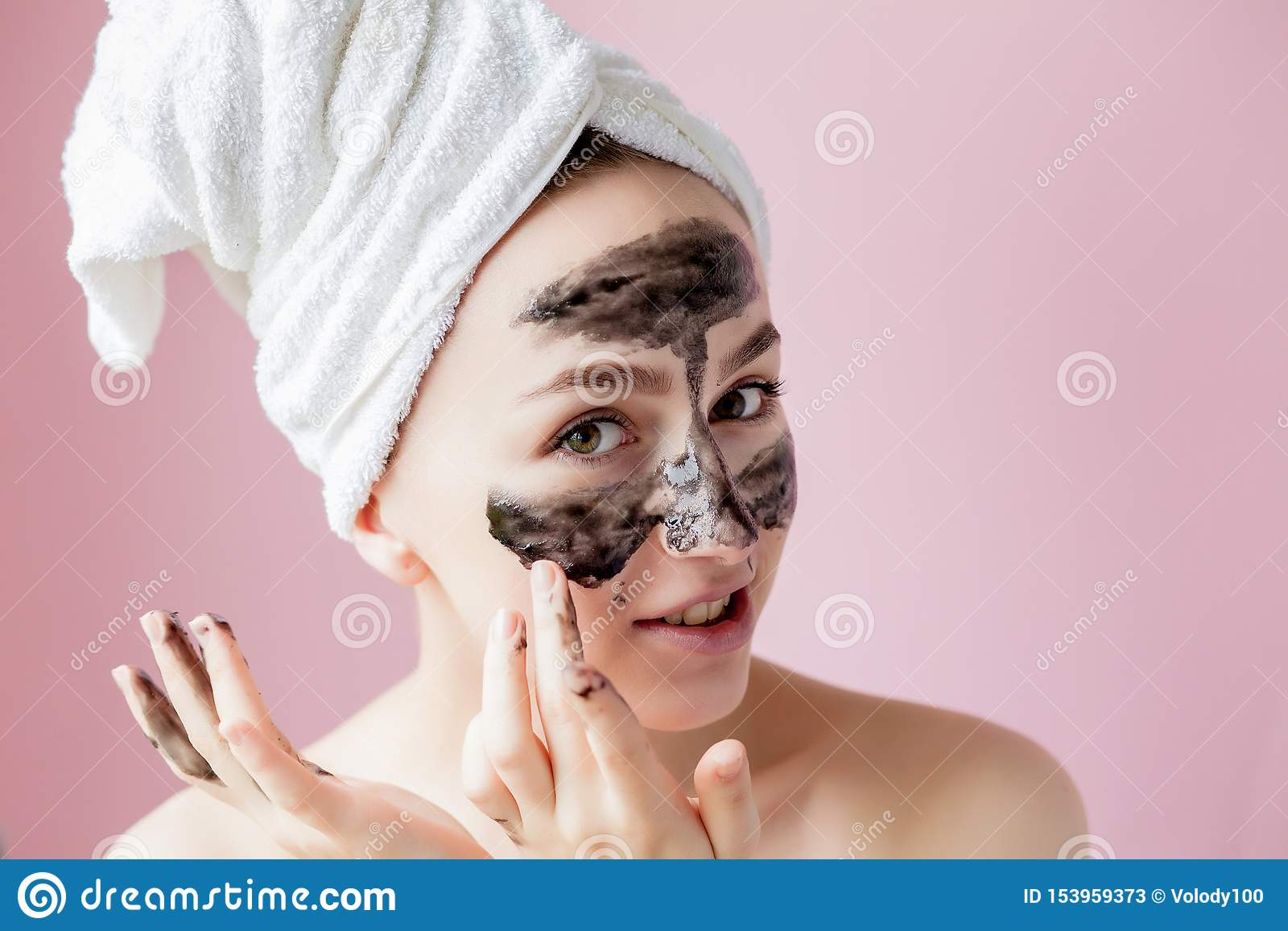 Beauty Cosmetic Peeling. Closeup Beautiful Young Female With Black Peel Off Mask On Skin. Closeup Of Attractive Woman With