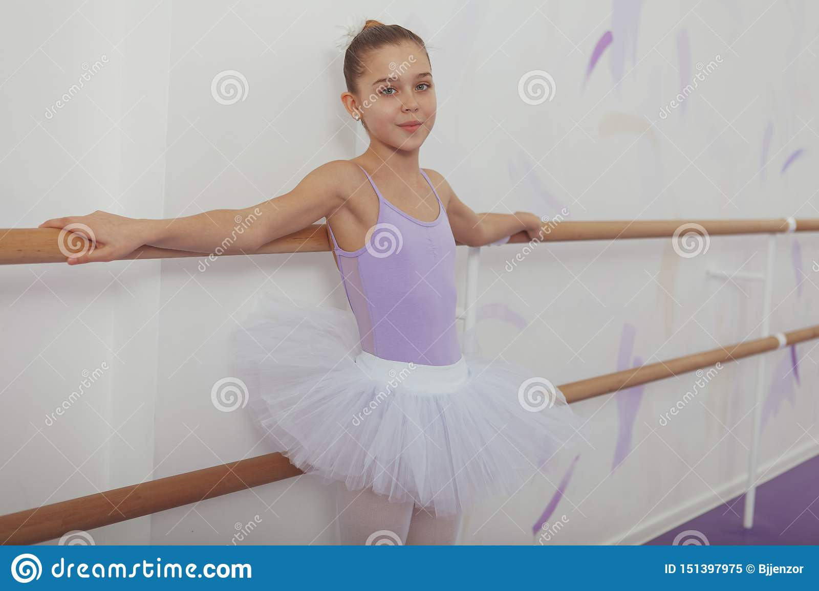 Gorgeous young girl ballerina practicing at dance studio