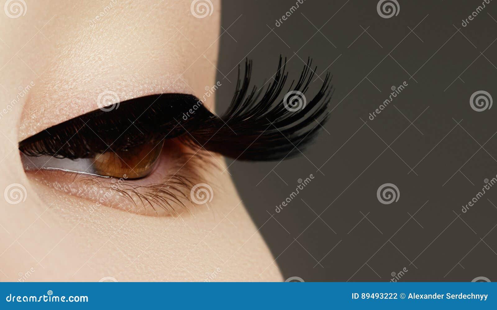 4fa58b99c5e Beauty face makeup. Make up. Eyelashes extensions. Perfect Make-up closeup.  Beauty model with perfect skin. Woman eye with long eyelashes. Eyelash  extension