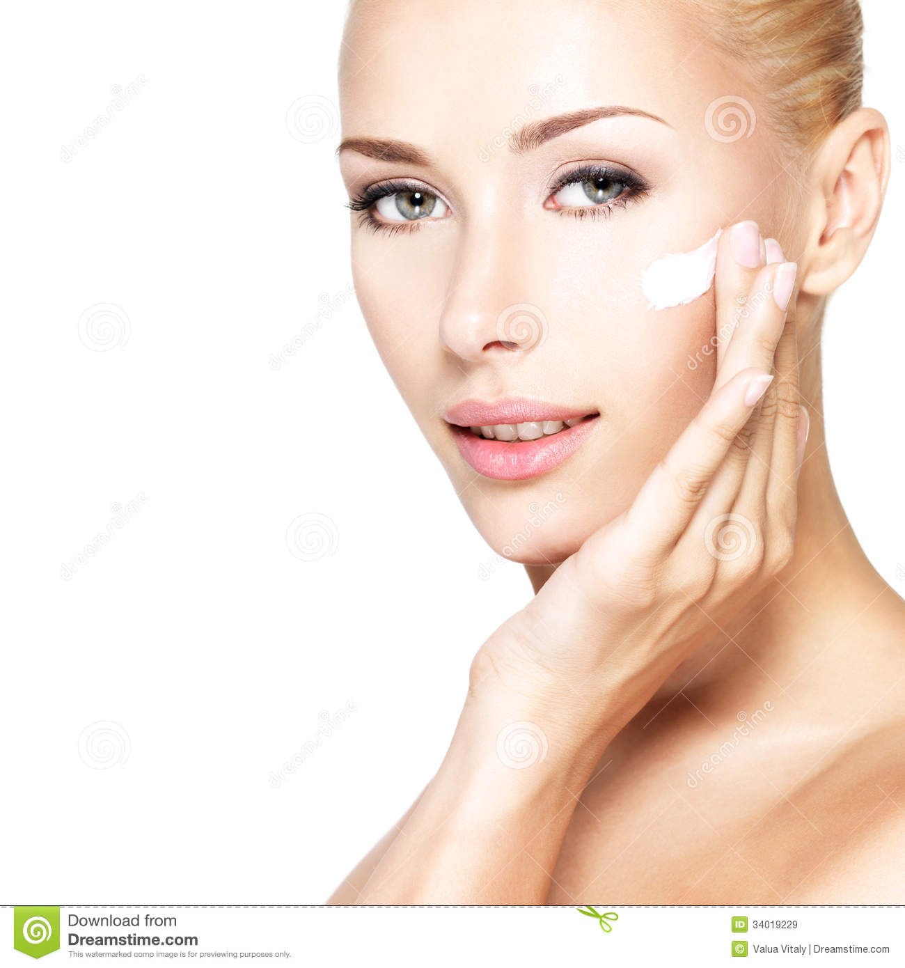 Beauty Face Of Woman Applying Cosmetic Cream On Face