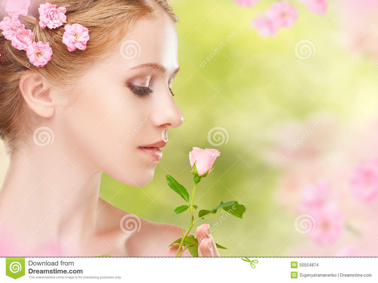 Beauty face of young beautiful woman with pink flowers in her ha royalty free stock photo download beauty face of young beautiful woman with pink flowers dhlflorist Gallery