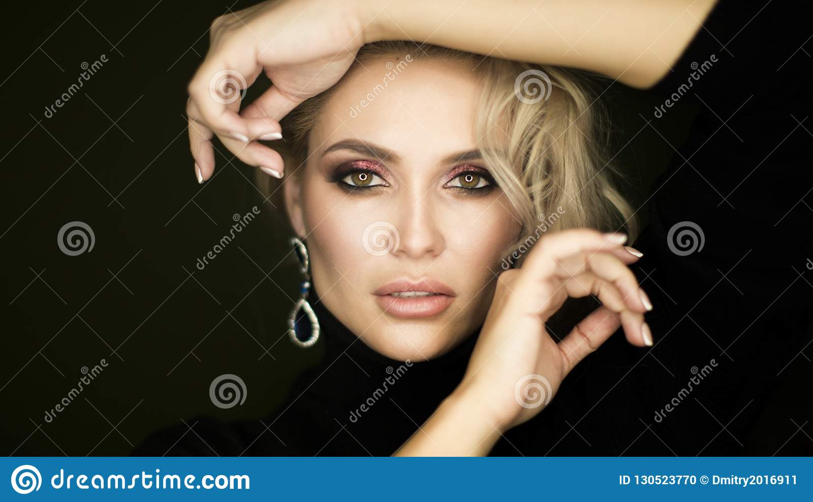 Beauty face of young caucasian model girl with natural nude makeup and hand near clean skin. Skincare facial treatment