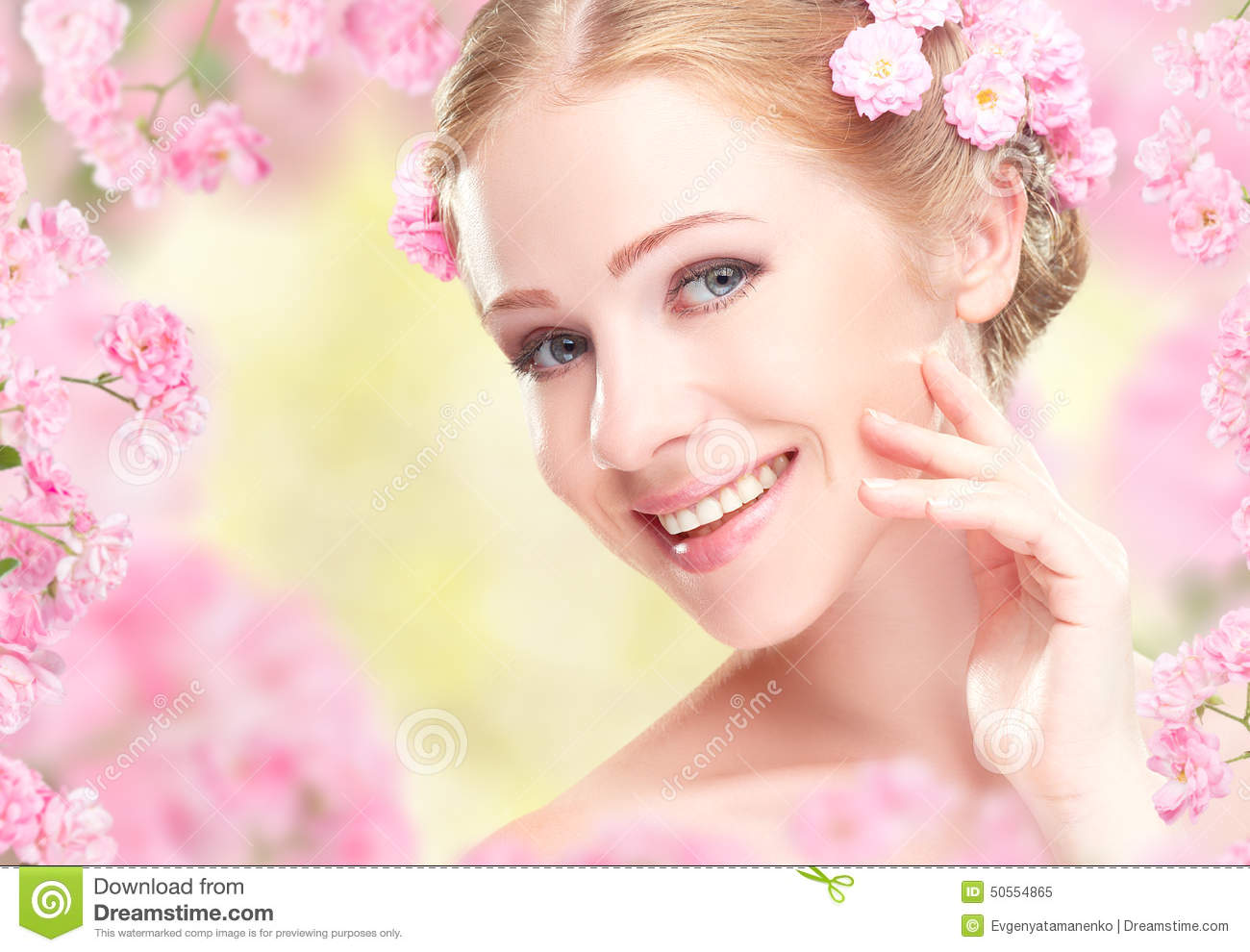 Beauty face of young happy beautiful woman with pink flowers in beautiful beauty face flowers hair happy pink woman dhlflorist Gallery