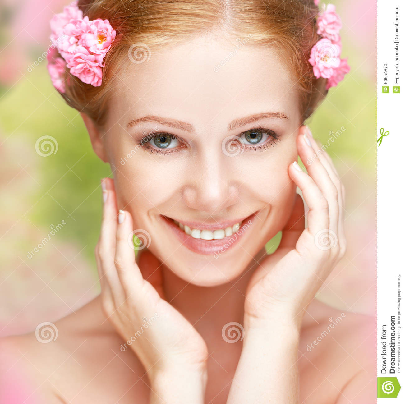 beauty-face-young-happy-beautiful-woman-pink-flowers-her-hair-50554870.jpg