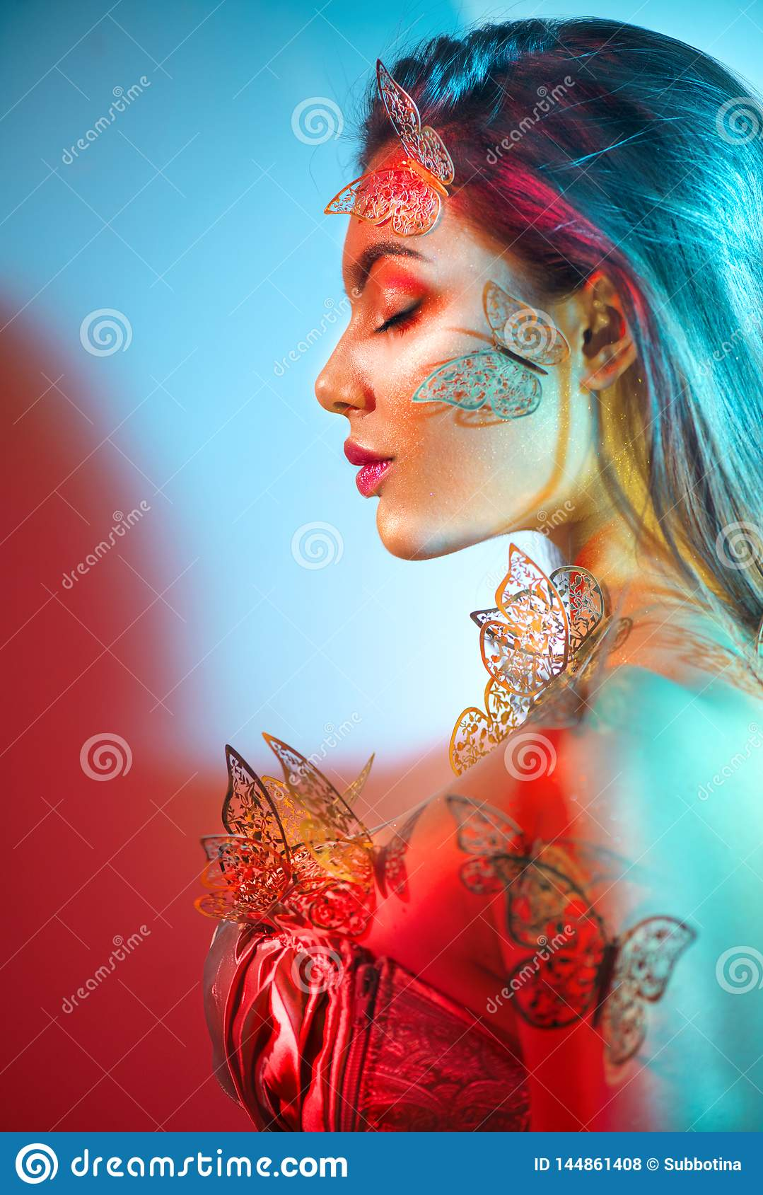 Beauty fantasy model spring girl in colorful bright neon lights. Portrait of beautiful summer young woman in UV. Art design