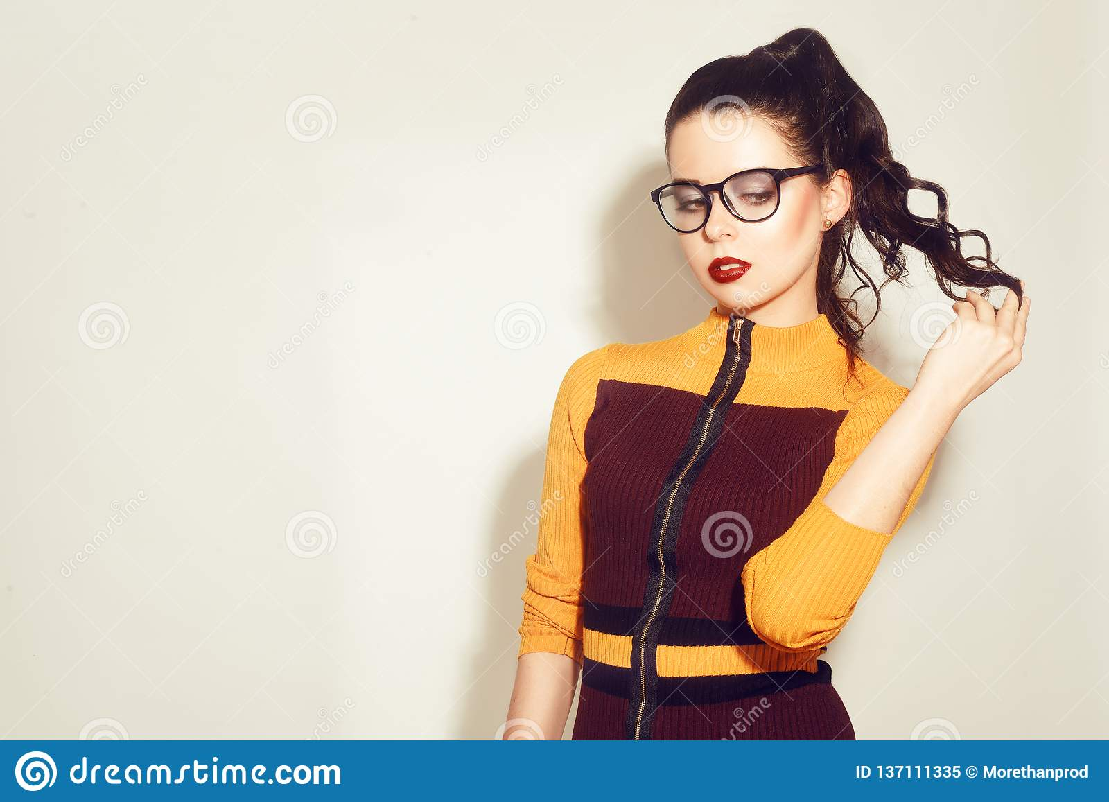 ccaa82d09ed Beauty Fashion brunette model girl wearing stylish glasses. woman with  perfect makeup
