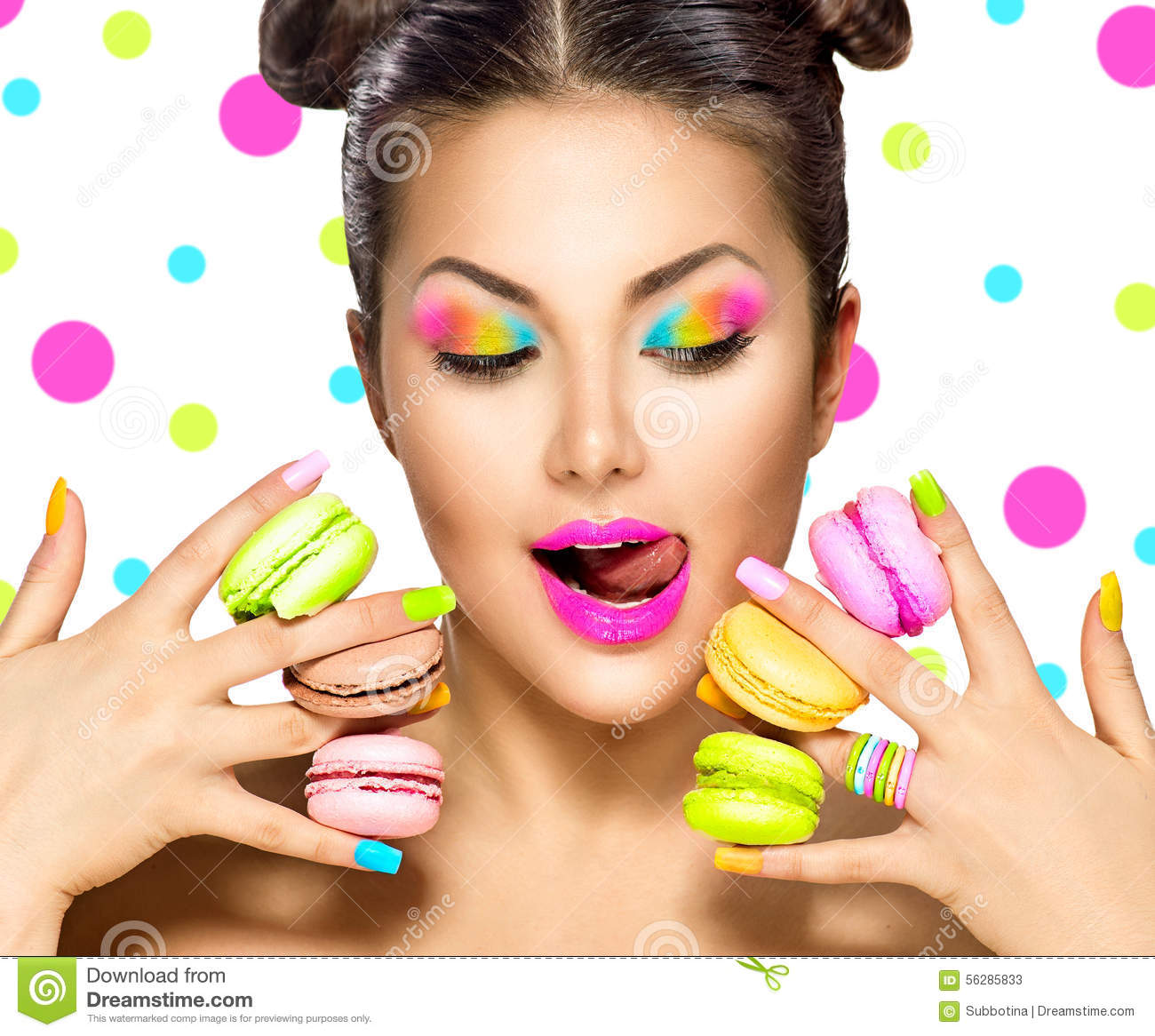 Beauty Fashion Model Girl Taking Colorful Macaroons Stock