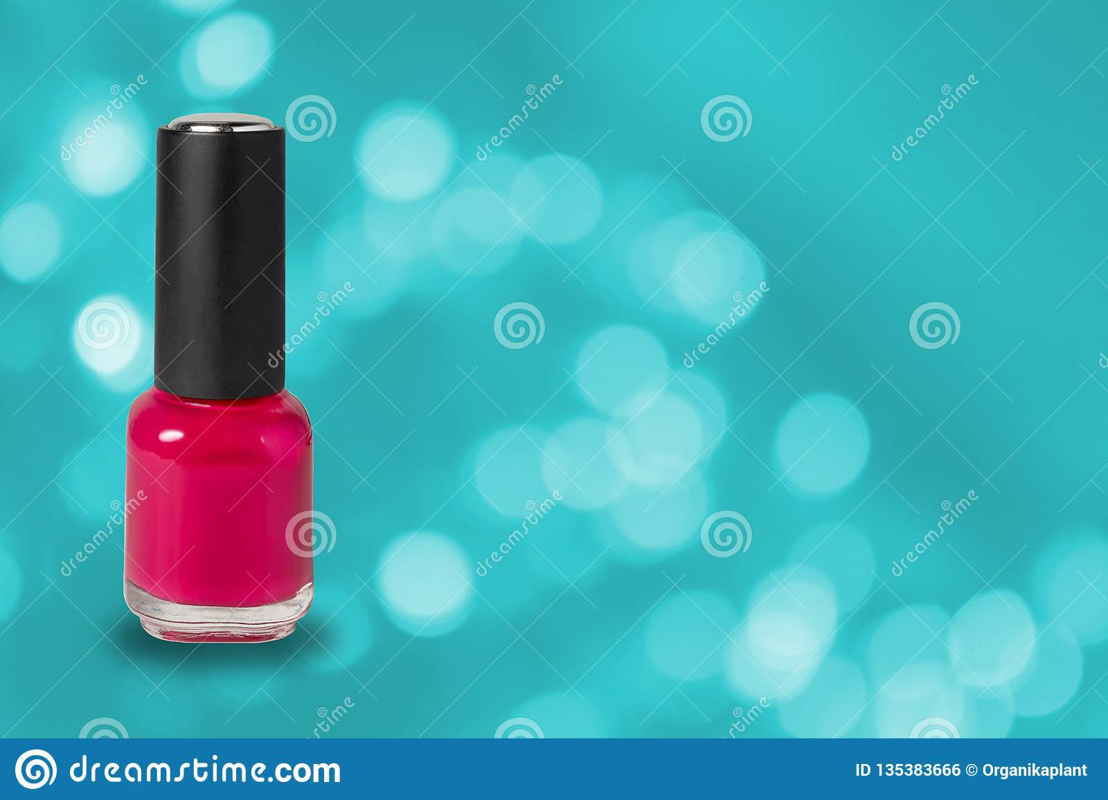 Beauty, fashion and nail art. Manicure art cosmetic tools, bottle of red colorful gel nail polish on blue bokeh background with