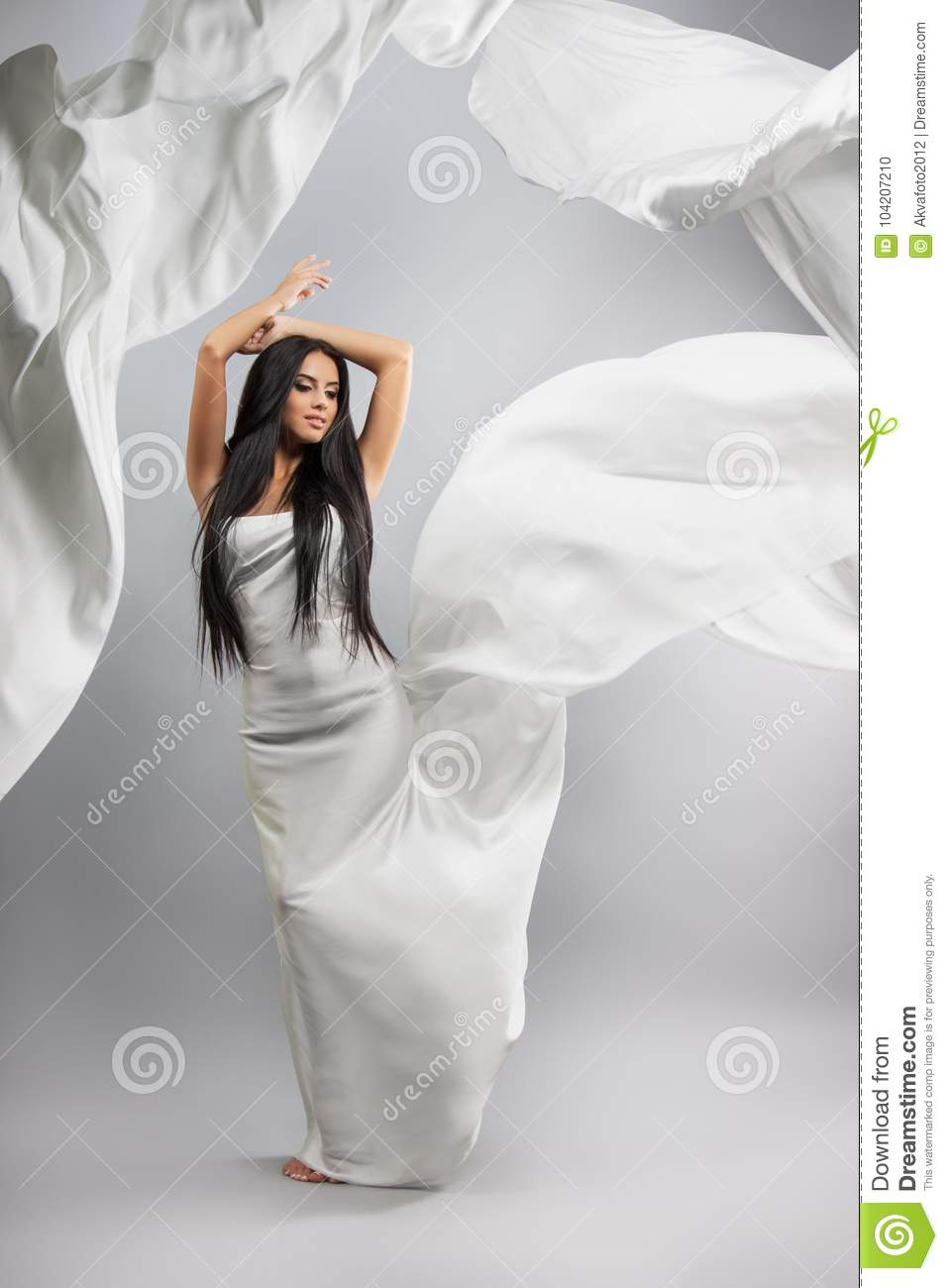 Beauty Fashion Photo Of Young Beautiful Girl In A Flying White Cloth The Gray Background Waving Wind Fabric