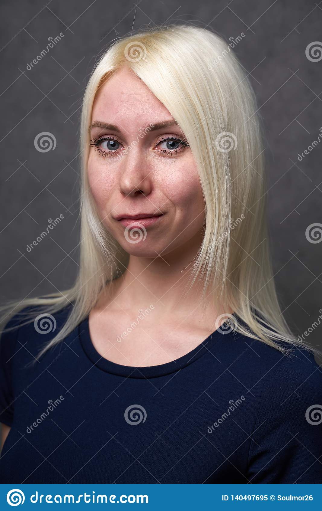 Beauty female blond in black casual clothes on gray background