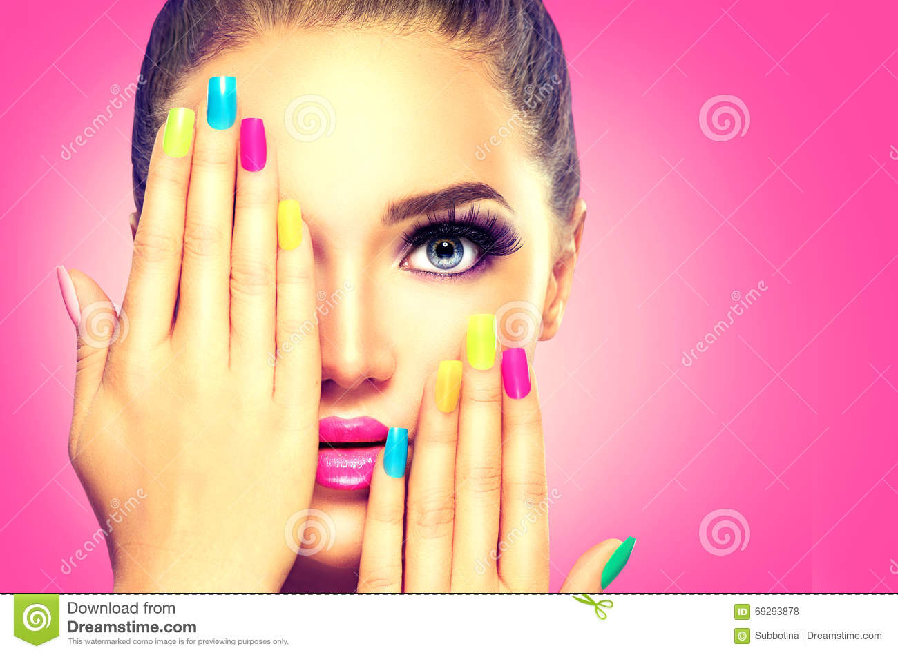 Beauty girl face with colorful nailpolish