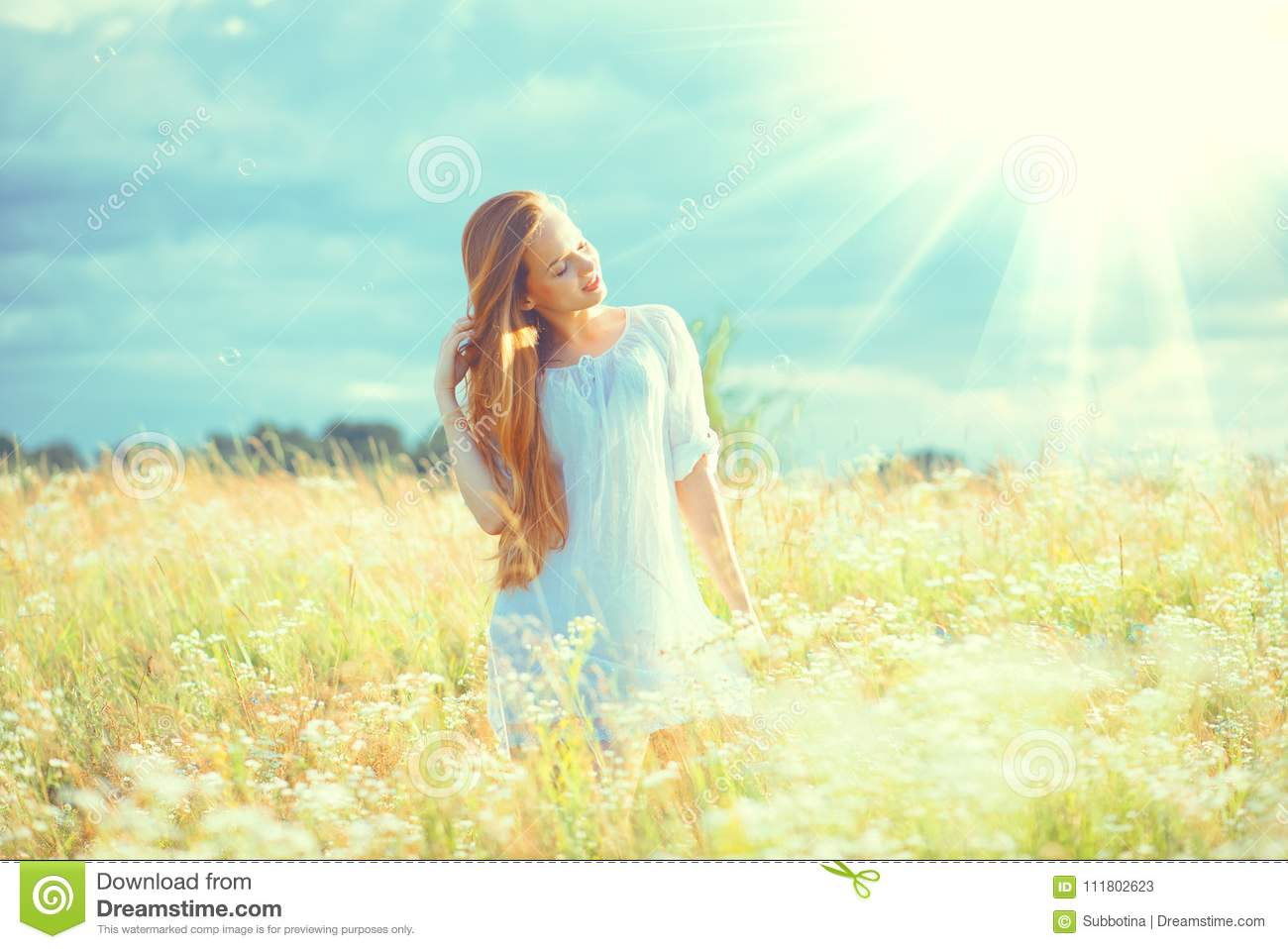 Beauty girl outdoors enjoying nature. Beautiful teenage model girl with healthy long hair in white dress