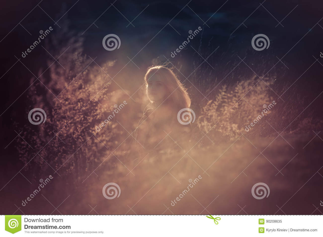 Beauty Girl Outdoors enjoying nature. Beautiful Teenage Model girl with long healthy blowing hair running on the Spring Field, Sun