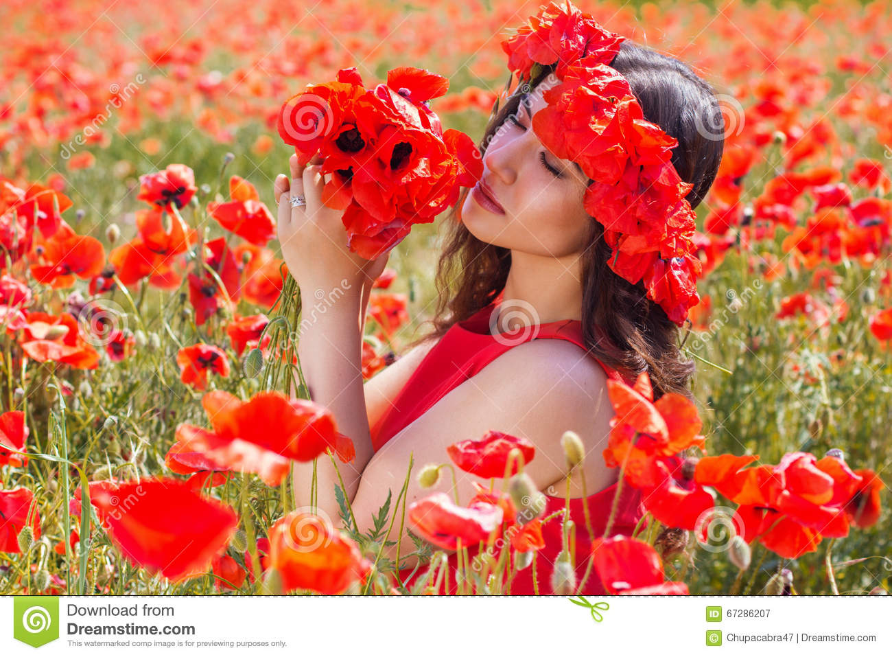 Beauty Girl With Wreath Of Poppies Flowers Stock Photo