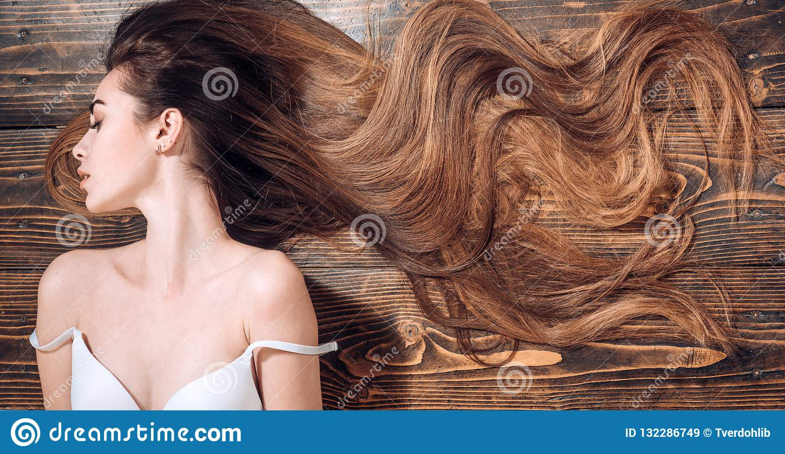 Beauty hair Salon. Woman with long beautiful hair. Fashion haircut. Beauty girl with long and shiny wavy hair. Trendy