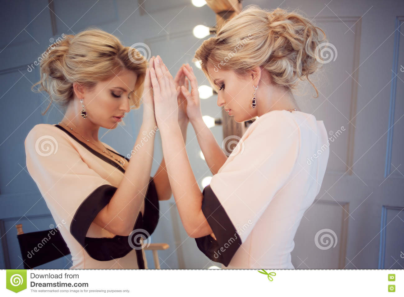 Beauty luxury blonde woman with and mirror, close-up