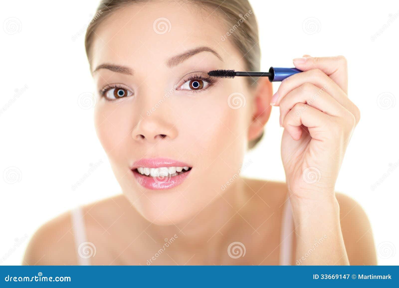 Beauty makeup woman putting mascara eye make up
