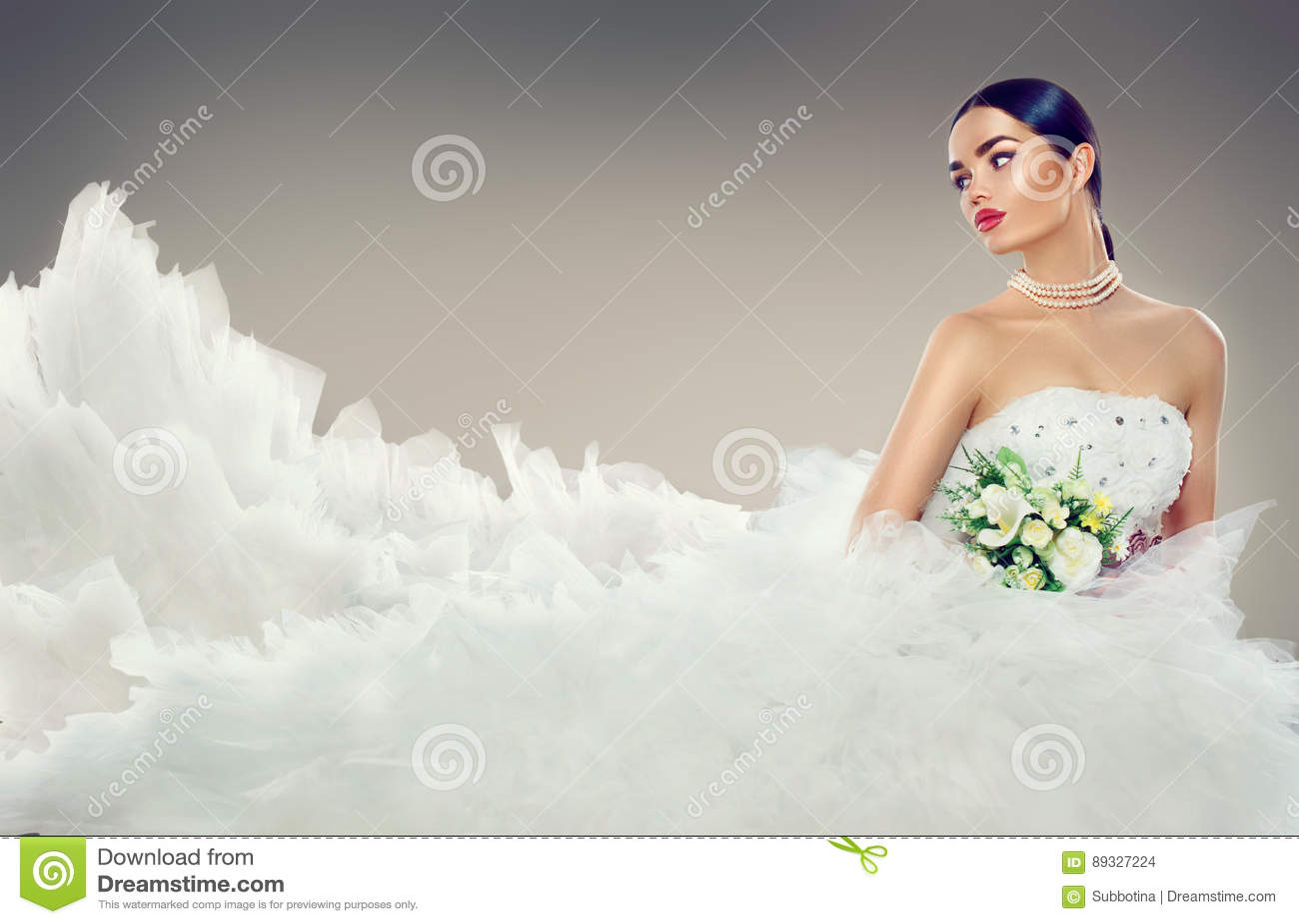 Beauty model bride in wedding dress with long train