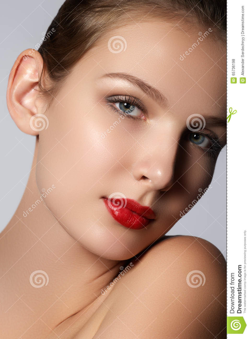 Beauty model girl with perfect make-up looking at camera isolated over white background. Portrait of attractive young woman