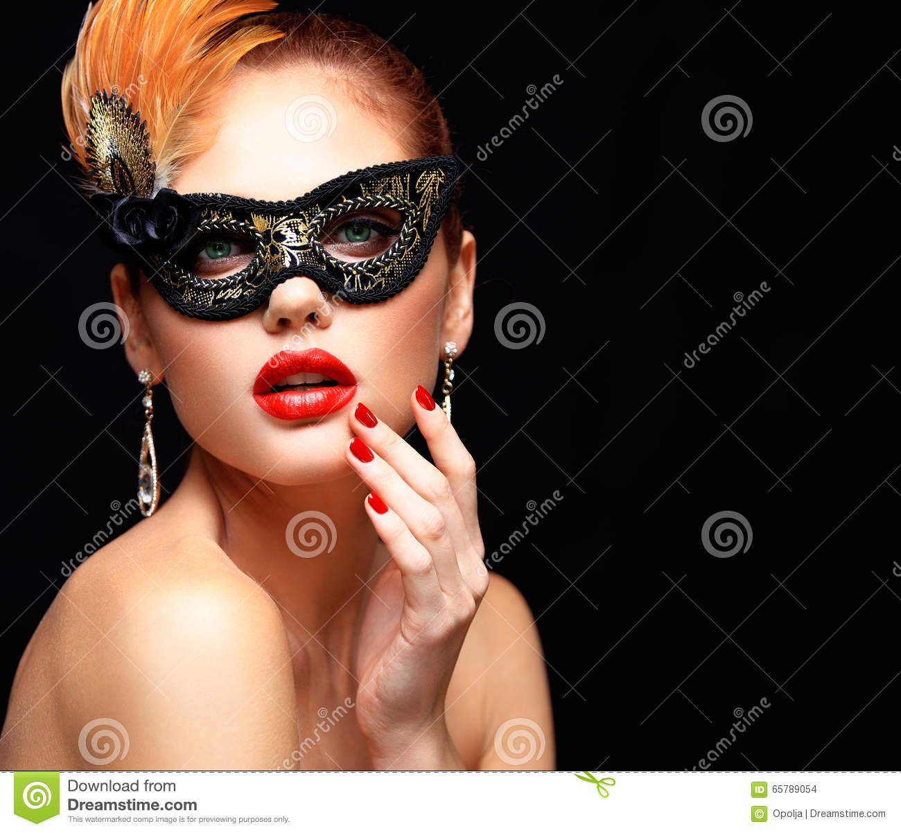 Beauty model woman wearing venetian masquerade carnival mask at party isolated on black background. Christmas and New