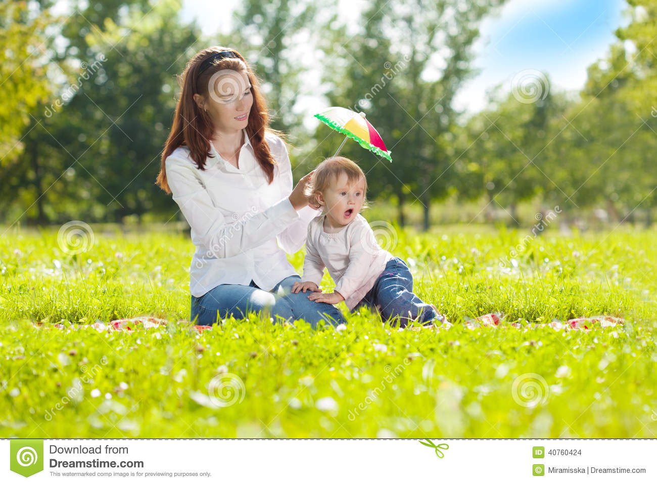Beautiful mom and baby outdoors happy family playing in nature mom and baby mother and child
